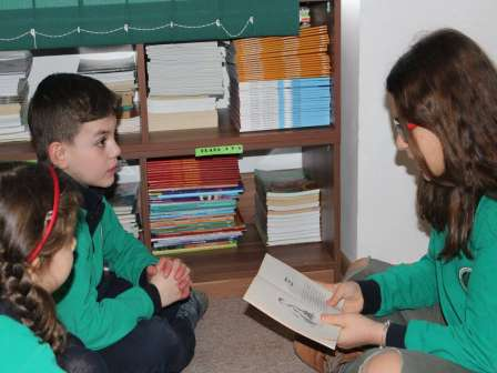 Elder students reading to younger ones